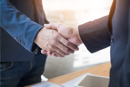 two-confident-business-man-shaking-hands-during-meeting-in-the-office-success-dealing-greeting-and-partner-concept